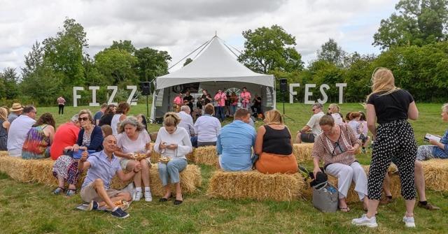 Alresford Ukulele Jam entertaining the crowd at Hampshire Vineyards Sparkling Wine Festival or Fizz Fest
