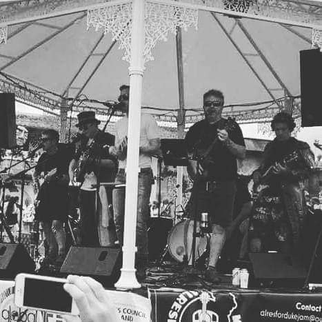 Alresford Ukulele Jam play at Boomtown CH11 on the Bandstand in Paradise Heights